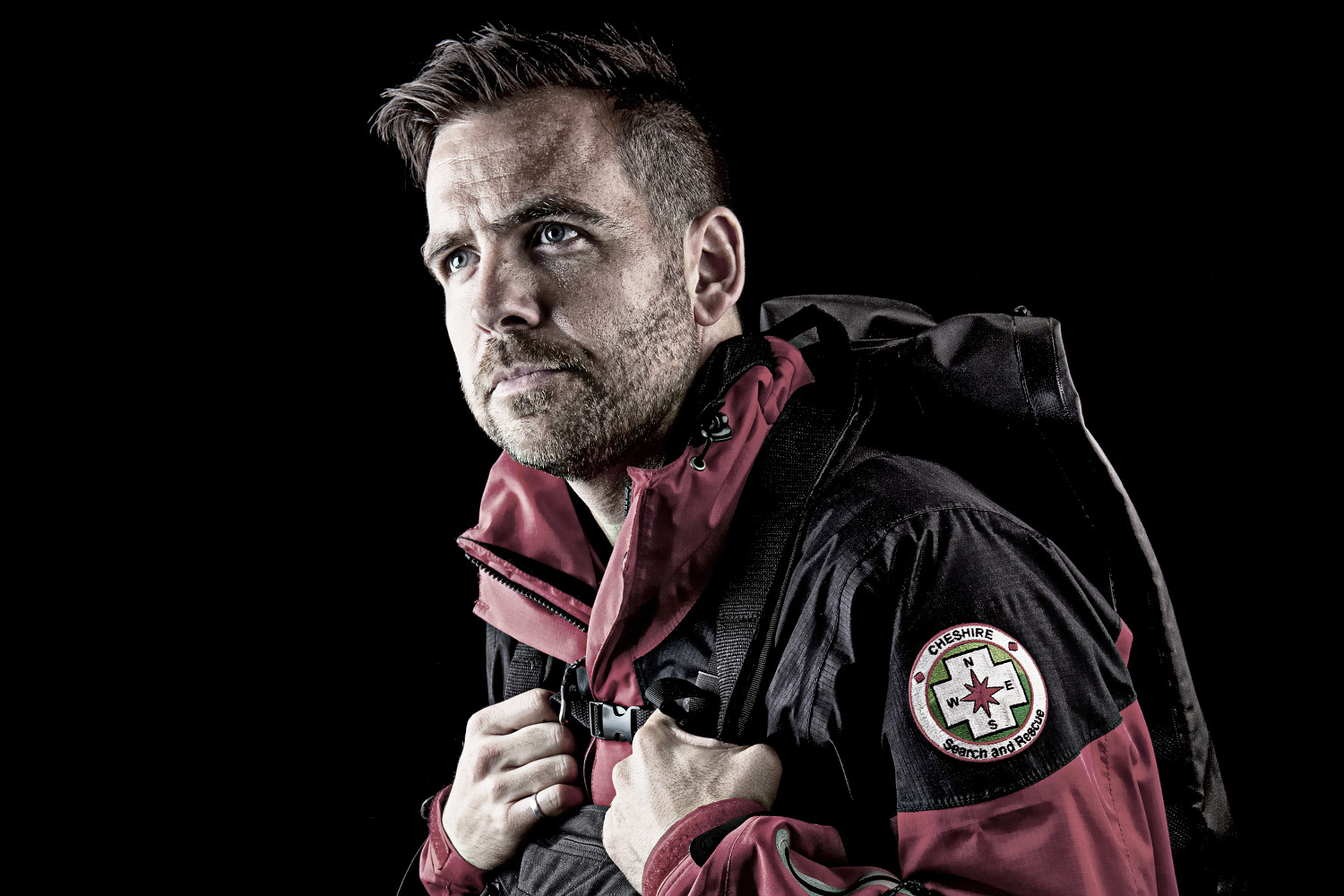 Commercial Portrait Photograph of man in Weather Proof Jacket and Back Pack from Cheshire Search and Rescue by Paul Worpole Photography