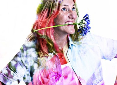"""Portrait of Woman Holding Flower in Mouth Smiling hand on Hips Exhibition Portrait of Town Councillor Yvonne Bancroft from the recent """"Knutsfordian"""" exhibition of 16 images © Paul Worpole Photography"""