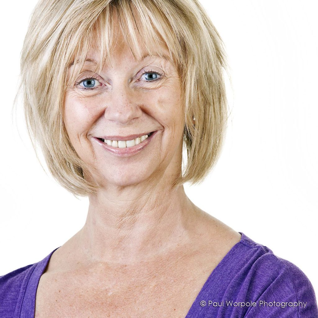 High Key Portrait woman Pilates Teacher Purple Top Blonde Hair © Paul Worpole Photography