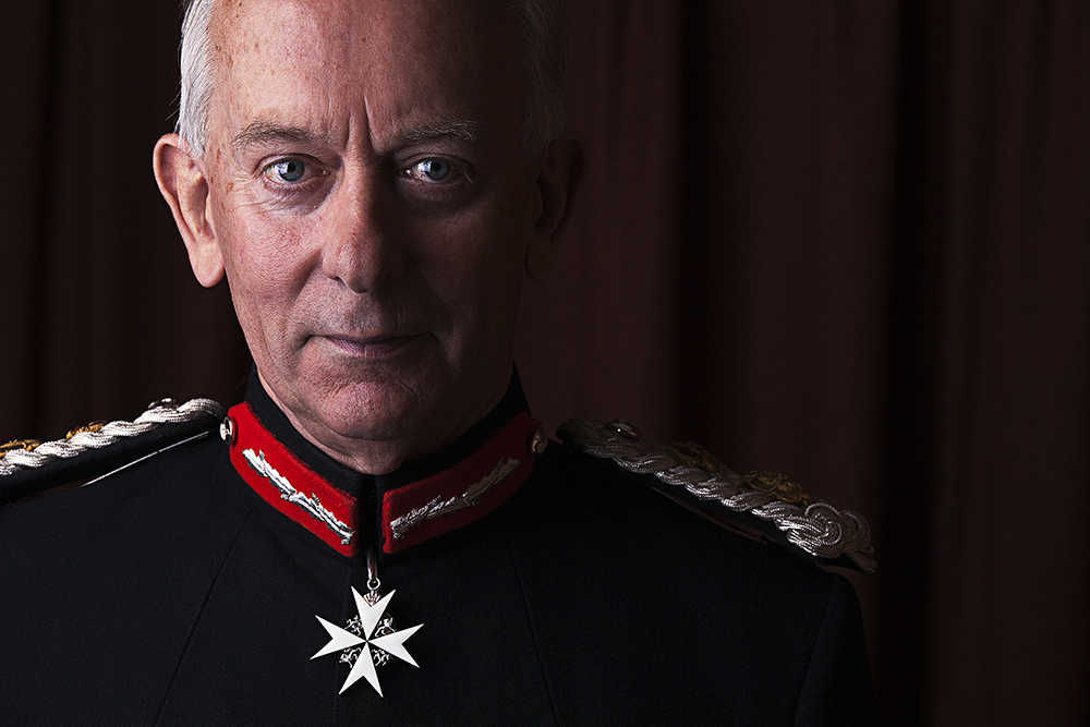 David Briggs Photographic Portrait Lord-Lieutenant Maltese Cross on Black Uniform with Red Epaulettes © Paul Worpole Photography