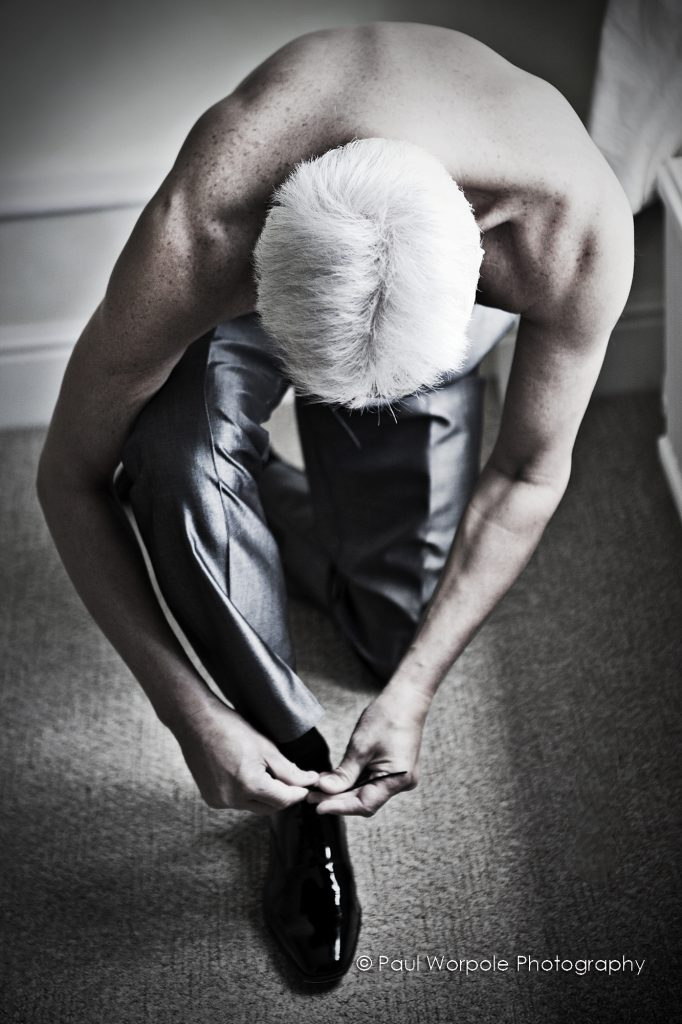 Natural Light Portrait Conceptual Man Tying Shoelaces White Hair by Paul Worpole Photography