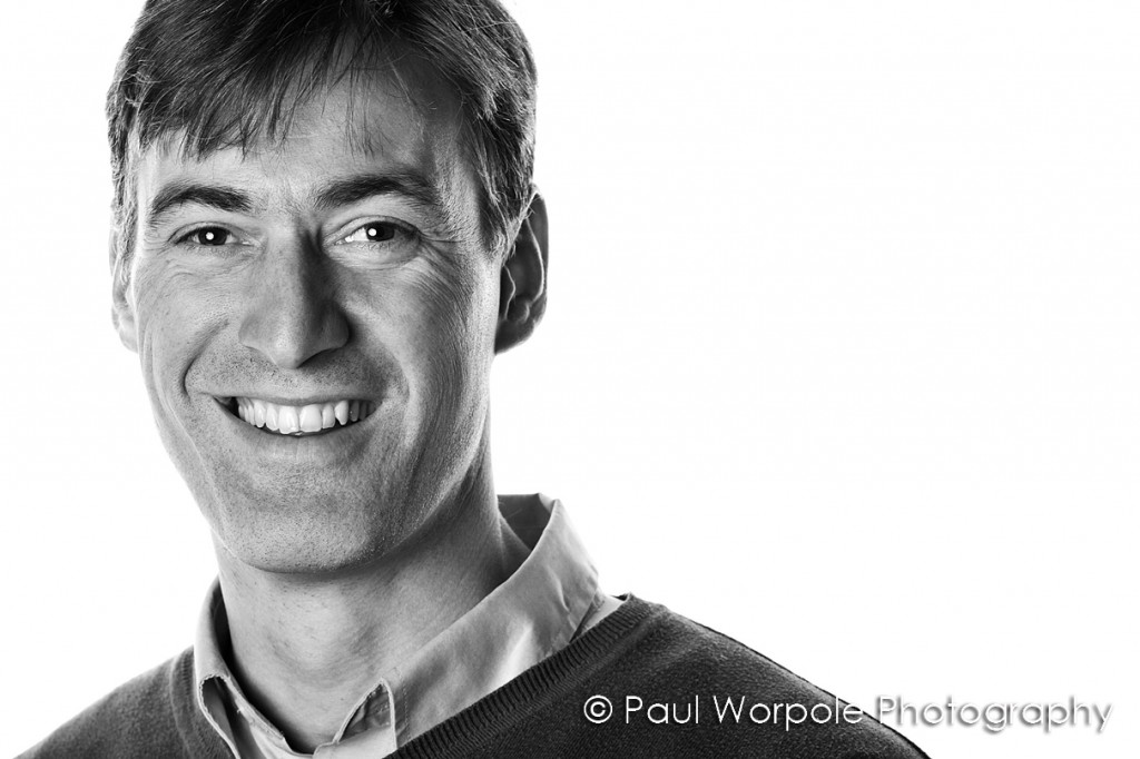 High Key Staff Shots Black and White Portrait of Man smiling Staff Portraits © Paul Worpole Photography