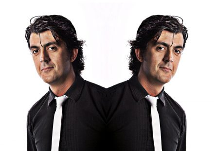 Professional Portrait Photography of a Man in Black shirt with white tie - the image is mirrored to create to people © Paul Worpole Photography