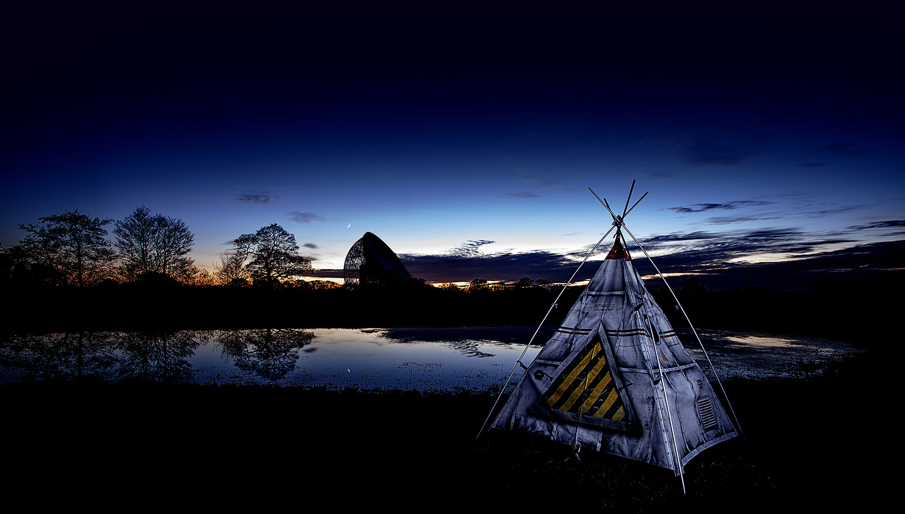 Industrial Photography of a Childs Rocket tent in Cheshire with Jodrell Bank in the Background at Dusk by Paul Worpole Photography