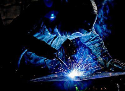 Industrial Photography Man with Welders Helmet Welding Steel Sparks Flying © Paul Worpole Photography