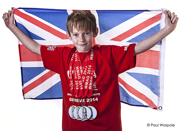 Boy in Red T shirt Holding Union Flag MMA Fighter