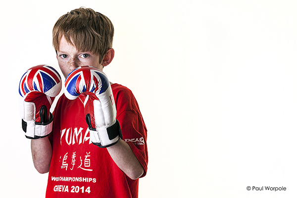 Boy in Red Tshirt with Boxing Glovess MMA fighter on white background
