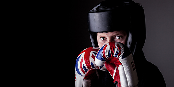 Boy with Union Flag Boxing Gloves and Black Face protectore used in MMA by Paul Worpole