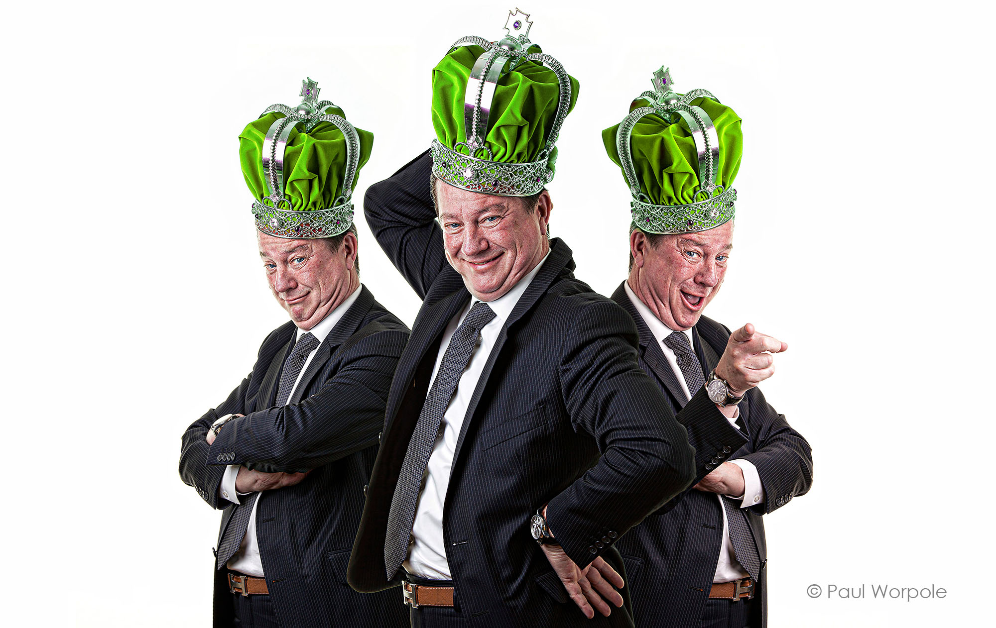 Three-images-of-the-same-man-with-a-green-crown-on-his-head-making-facial-expressions