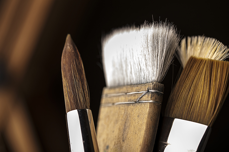 Close up detail image of water colour brushes