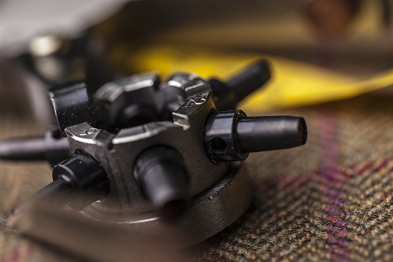 Leather hole punch on tweed