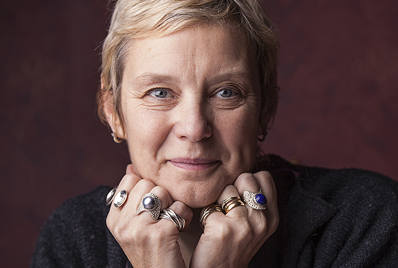 Portrait of woman with a ring on each finger