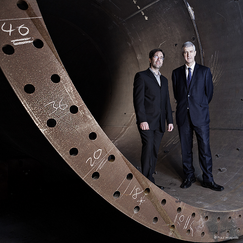 Environmental Portraits of two busnessmen in a large tube in Hutchinson Engineering