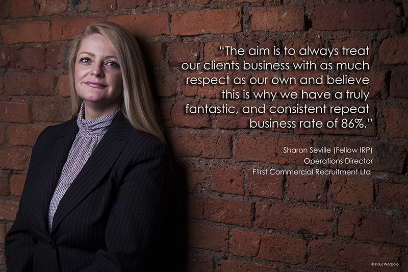 Environmental Portraits of business lady leaning against a brick wall © Paul Worpole Photography