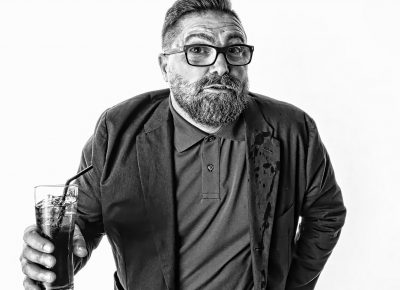 Black & White portraits Manchester of a man with a beard and glasses holding a drink with a straw © Paul Worpole Photography