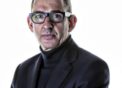 Dynamic Corporate Business Portraits Manchester of a Man with short Hair and Buddy Holly style glasses © Paul Worpole Photography