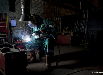 Portrait of Man Welding in Liverpool Industrial photography of man welding a pipe © Paul Worpole Photography