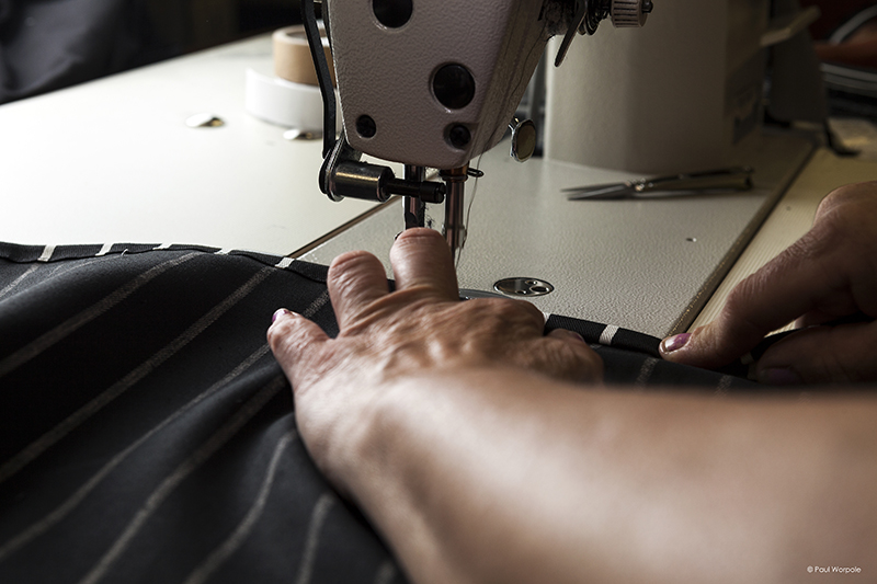 Hands of sewing machinist sewing pinstripe material ©Paul Worpole