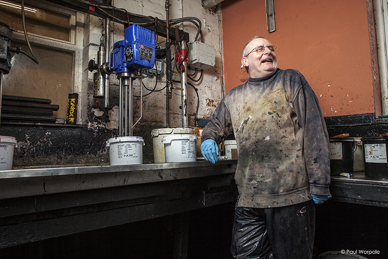 Commercial Portrait of a Man covered in fabric dye paint laughing © Paul Worpole Photography