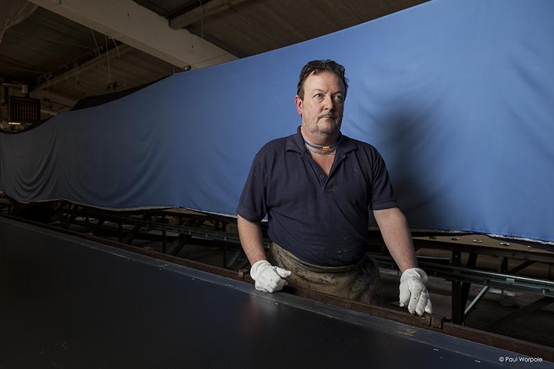 Screen Printer standing next to Blue Silk © Paul Worpole
