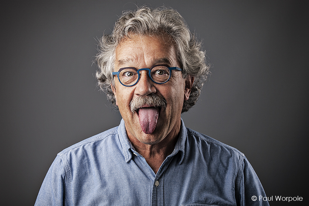 Man with glasses with tongue poking out looking like Albert Einstein © Paul Worpole
