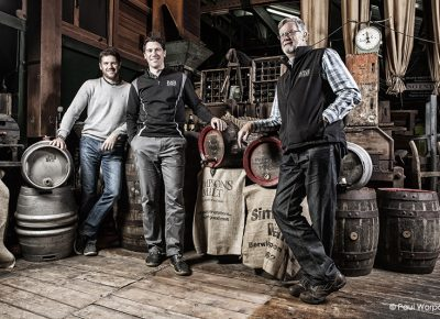 Commercial Portrait of Three Men Standing Around Barrels in Black Sheep Brewery for Clients Greystone Financial © Paul Worpole Photography
