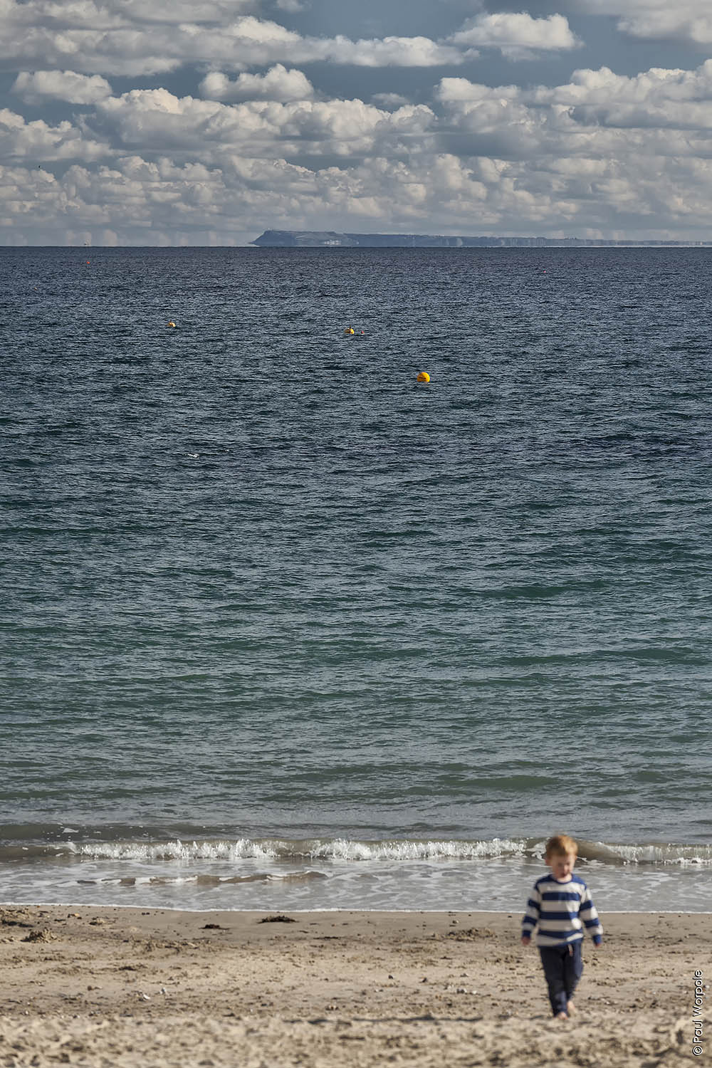 Commercial Advertising shot of Young Boy in stripped top walking on Beach at Lyme Regis © Paul Worpole Photography
