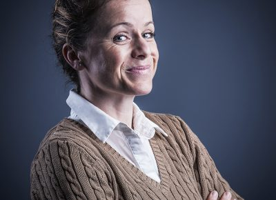 Business Photo Headshot of Woman with braided hair and a smile © Paul Worpole Photography