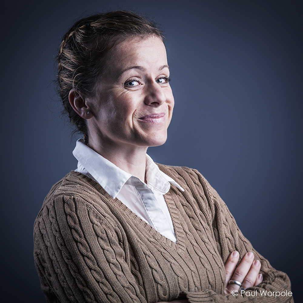 Corporate Headshot Portrait of Woman with braided hair and a smile © Paul Worpole Photography