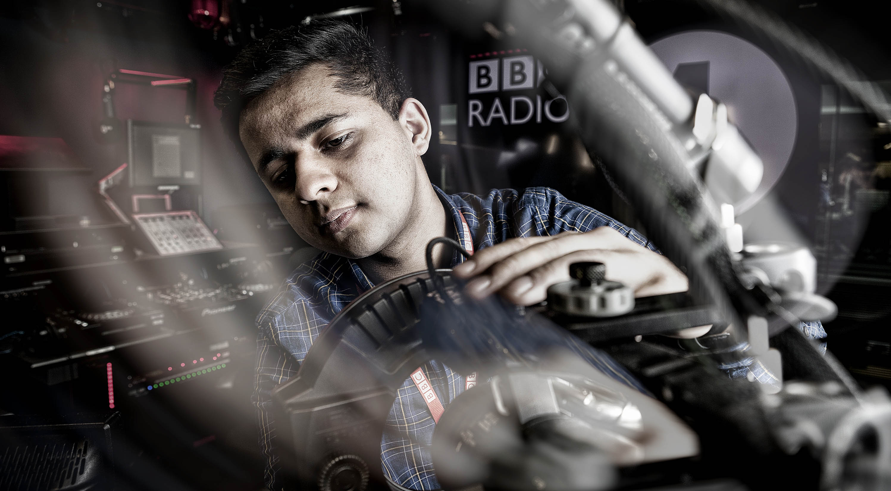 Technicians Make It Happen Industrial Photography at BBC Radio 1 Corporate Portrait of Technician at Adjusting a Mic in the Studio © Paul Worpole Photography
