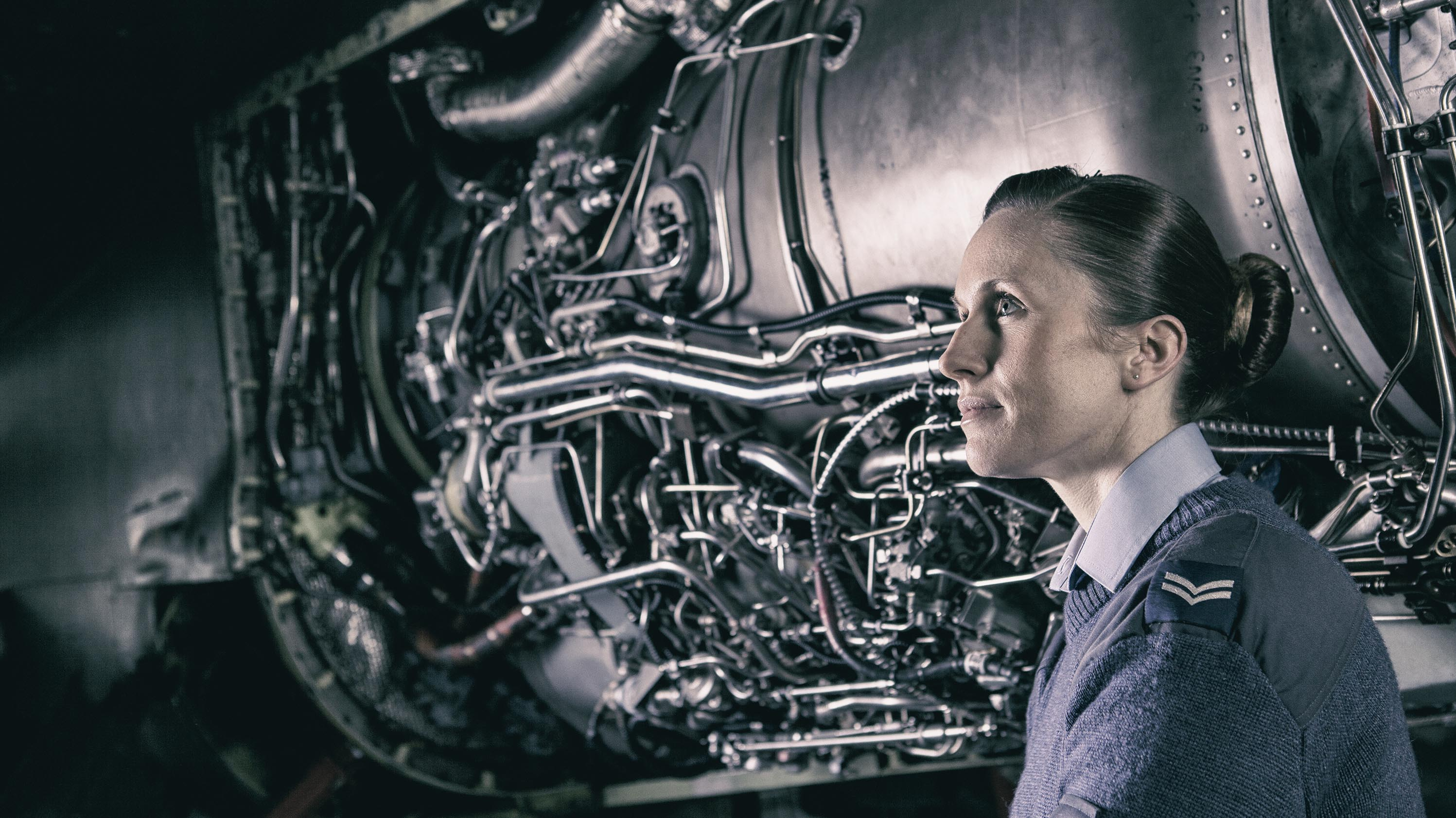 Industrial Photography Headshot of Woman Technician with Jet Plane engine in background at RAF Cosford © Paul Worpole Photography