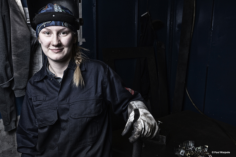 Technicians Make It Happen Project Portrait of Woman Welder with Face Mask Up Smiling © Paul Worpole Photography