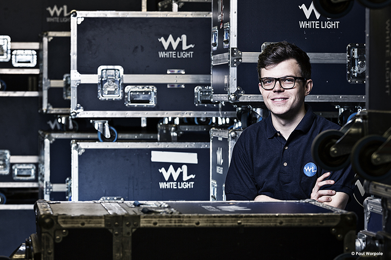 Technicians Make It Happen White Lights London Portrait of Technician Surrounded by Blue Transport Boxes with WL logo on them © Paul Worpole Photography