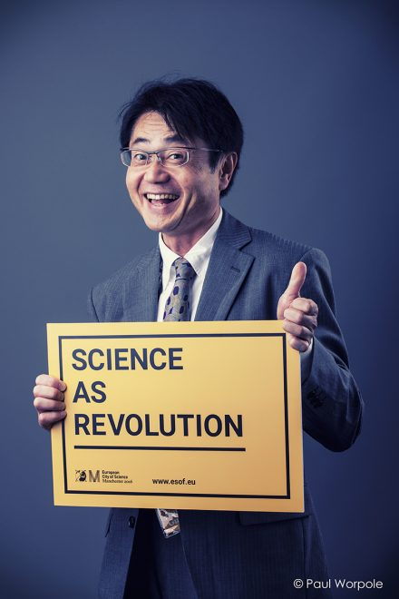 Commercial Photographic Portrait of Japanese man holding a sign with one thumb up © Paul Worpole