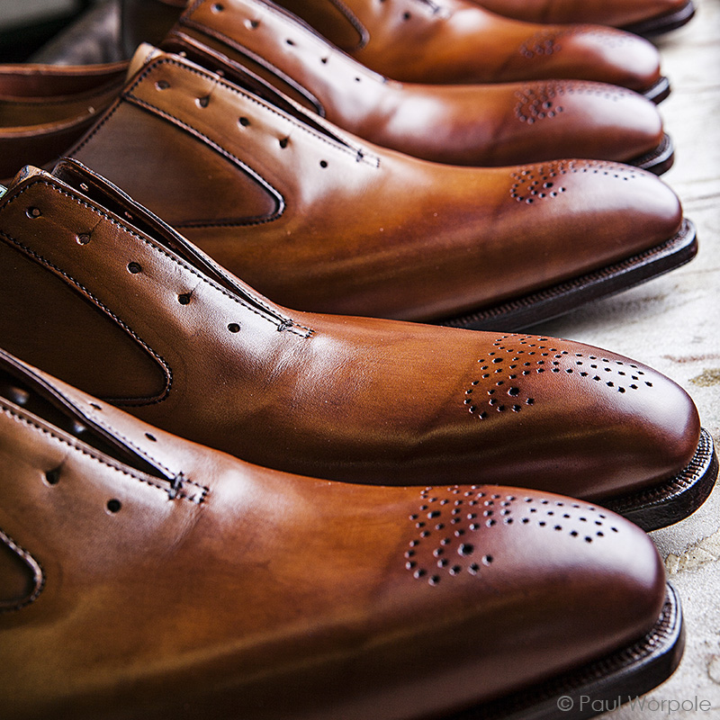 Crockett and Jones Northampton Shoemaker Close Up Toe Detail of Chestnut Leather Shoes in a row © Paul Worpole Photography