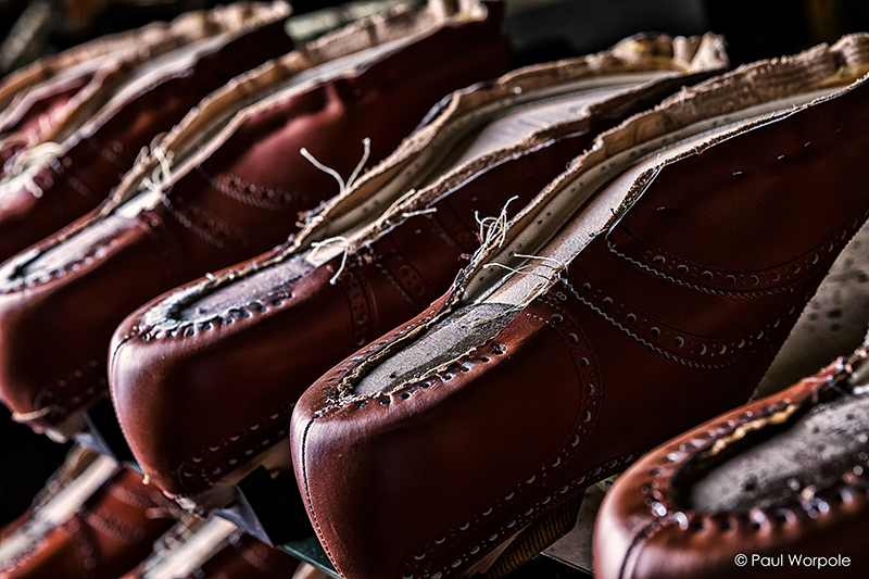 Crockett and Jones Shoemakers Northampton Close Up Detail Shoe Uppers in Chestnut Brown Leather Attached to Sole without Heel © Paul Worpole Photography