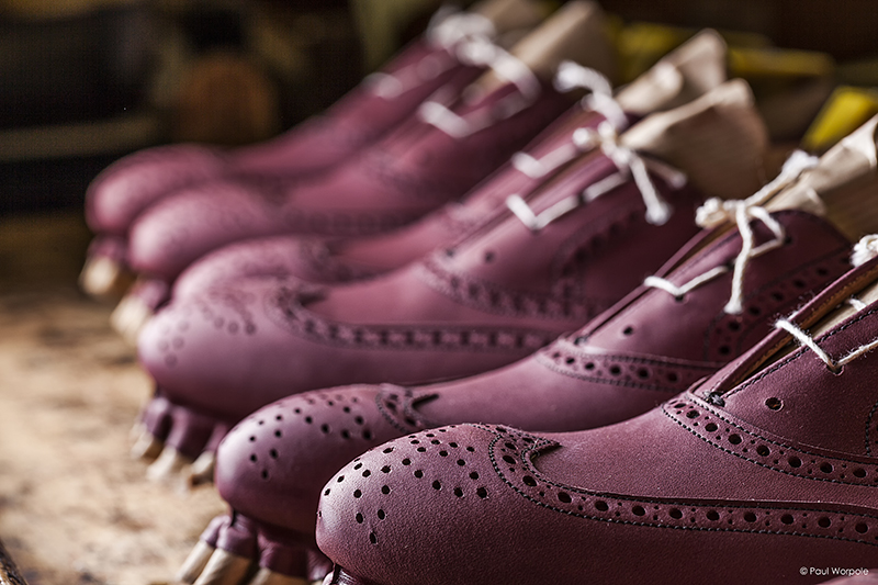 Crockett and Jones Shoemakers Northampton Close Up Detail of Brogue Design Stretched Over a Wooden Last for Drying © Paul Worpole Photography