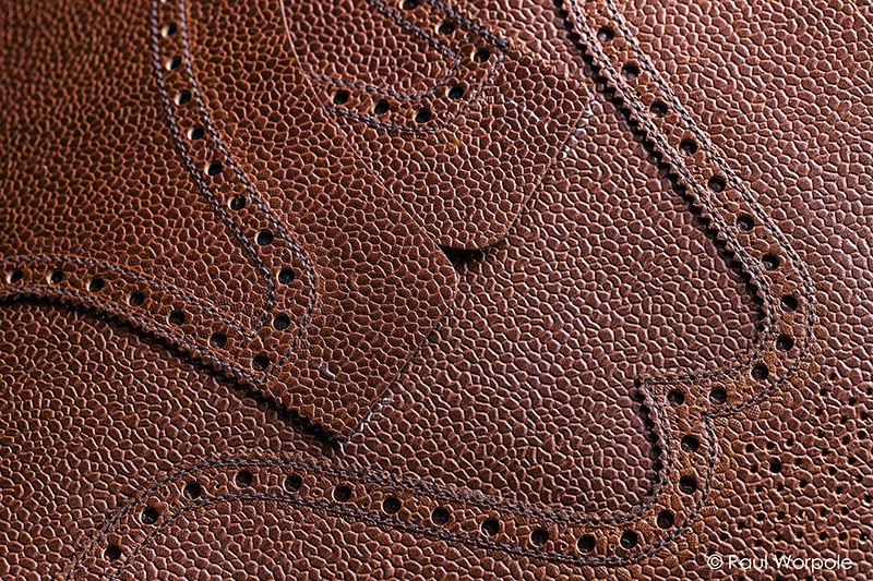 Crockett and Jones Shoemakers Northampton Close Up Detail of Brogue Design in Grained Leather Making Up Room © Paul Worpole Photography