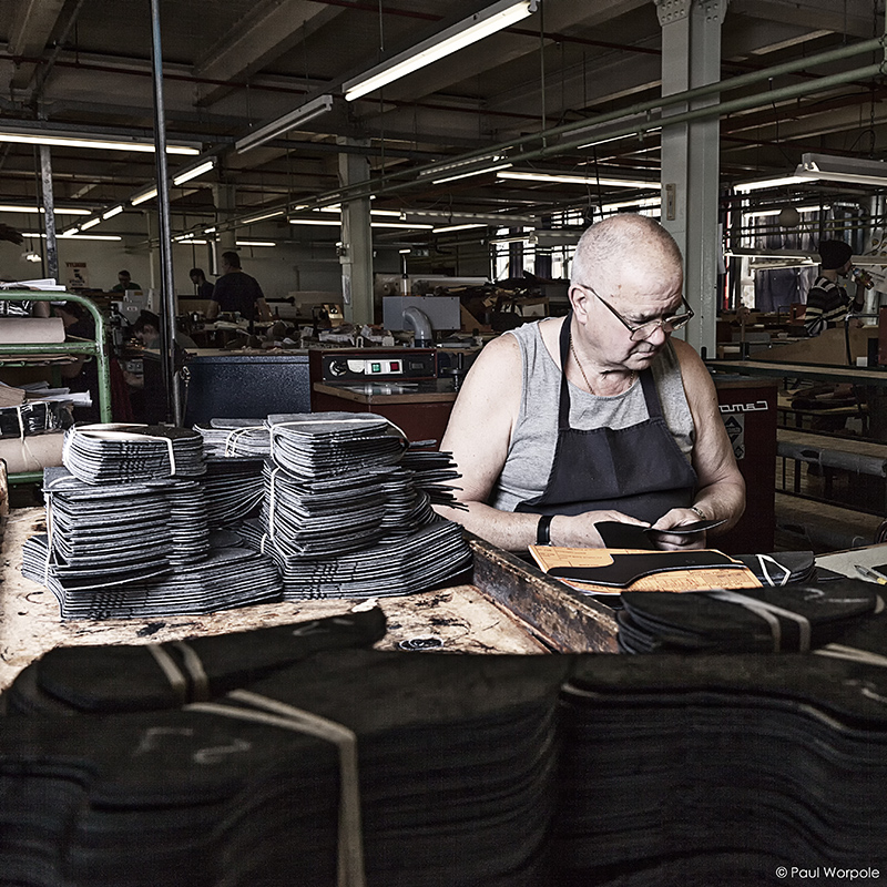 Crockett and Jones Shoemakers Northampton Man in Clicking Room Sorting Uppers in Black Leather © Paul Worpole Photography