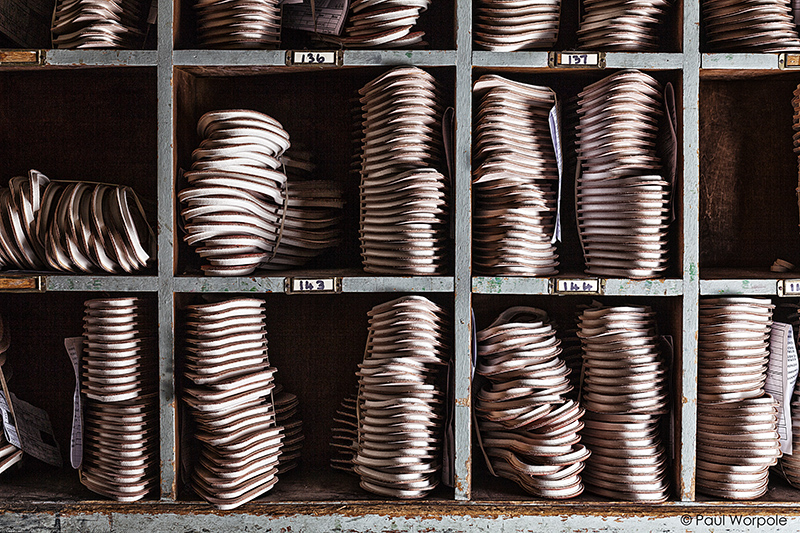 Crockett & Jones Shoemakers Northampton Shoe Liners Stacked in Blue Box Shelves © Paul Worpole Photography