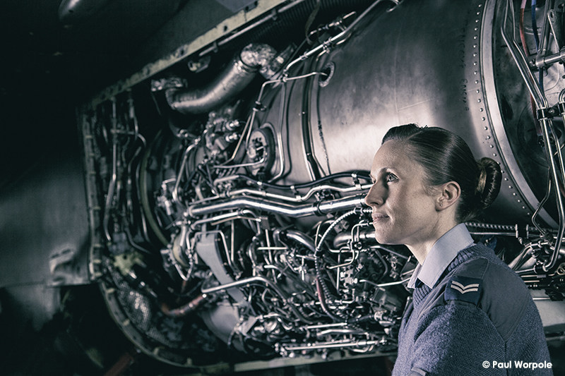 Technicians Make It Happen RAF Cosford Technician in charge of Hydraulics Woman next to jet engine © Paul Worpole Photography