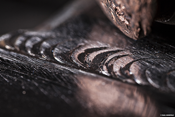 Close up macro shot of welds next to copper hammer © Paul Worpole Photography