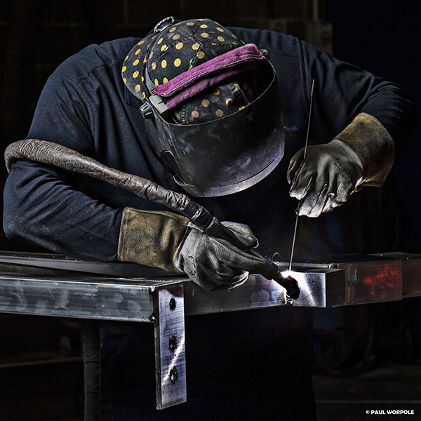 Man in welding mask welding aluminium with TIG welder © Paul Worpole Photography