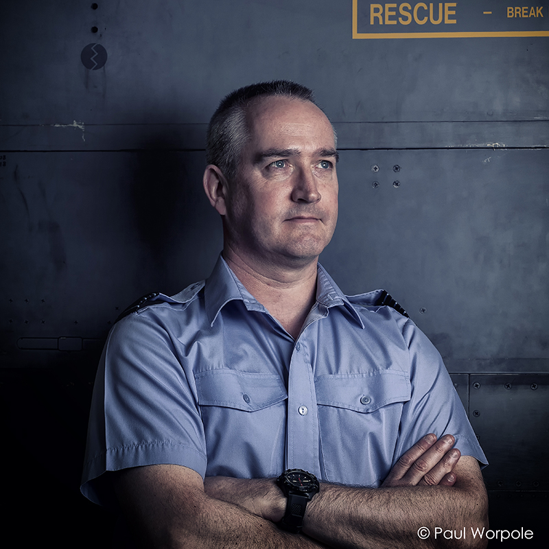 Commercial Portrait of RAF Station Commander Against Jaguar Jet Fighter Plane with Arms Folded © Paul Worpole Photography