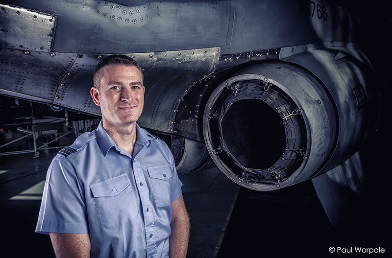 Commercial Portrait of RAF Technician Leaning Standing in Front of Jet Exhaust Fighter Plane smiling © Paul Worpole Photography