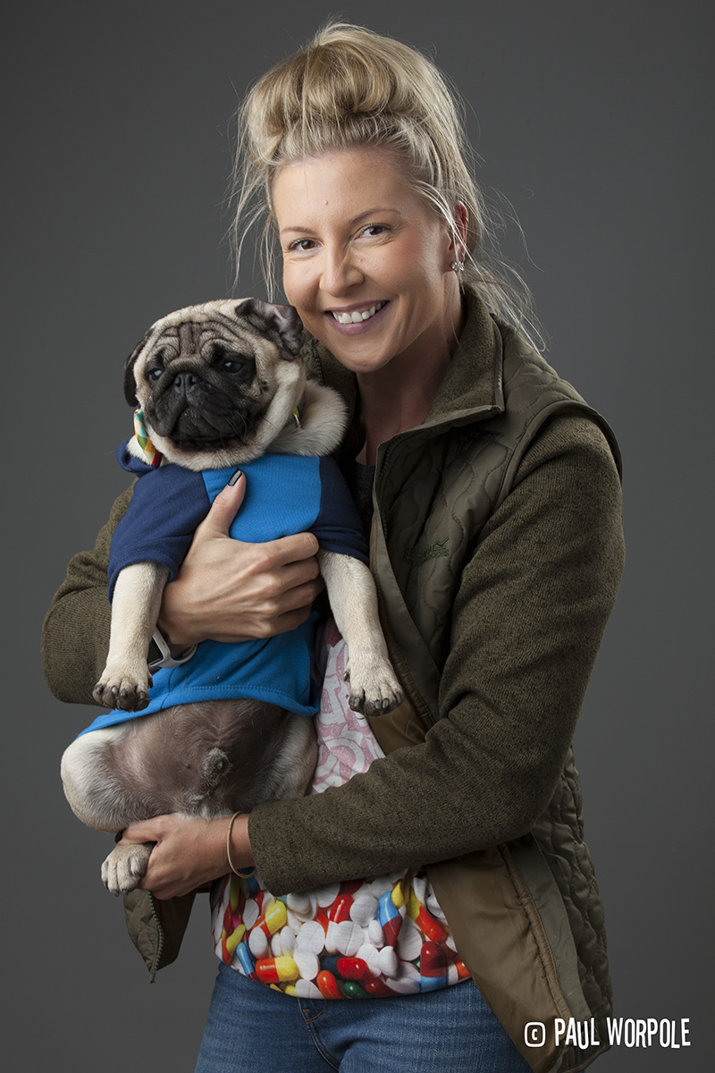 Woman holding a pug with a pug t shirt on © Paul Worpole Photography