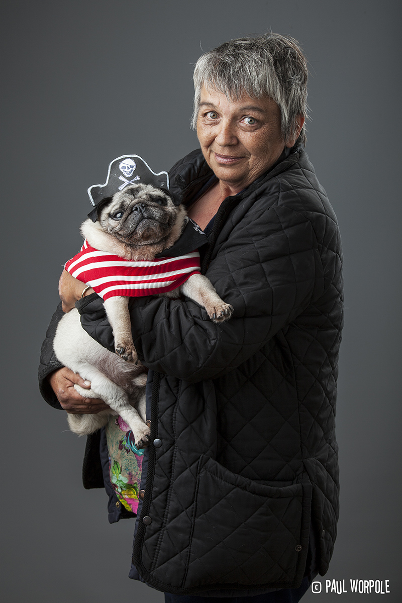 Woman holding pug in a Pirate outfit © Paul Worpole Photography