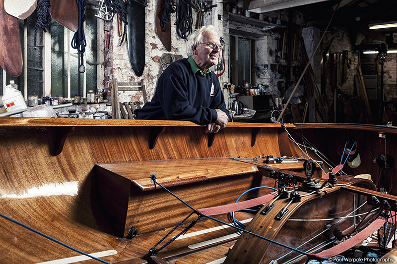 Boat Builder portrait of man leaning on hull of dinghy © Paul Worpole Photography