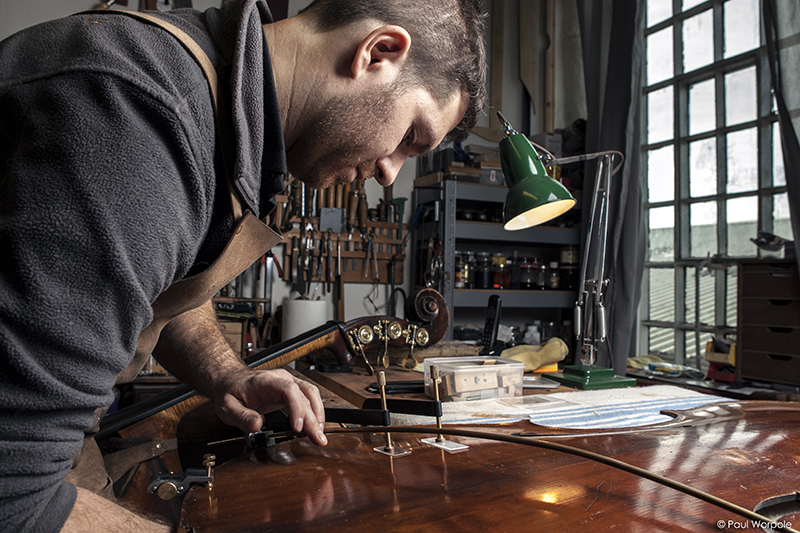 Sam Wells Bass Maker adding clamps to bass © Paul Worpole Photography