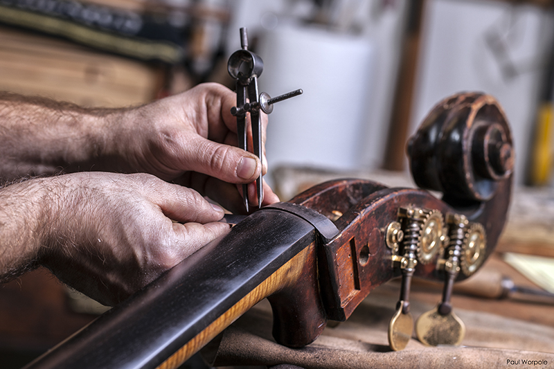 Sam Wells measuring ebony fingerboard with compass points © Paul Worpole Photography